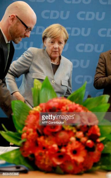 German Chancellor Angela Merkel and her conservative Christian Democratic Union party's secretary general Peter Tauber arrive for a meeting with...