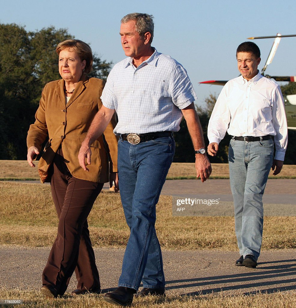 German Chancellor Angela Merkel and her husband Dr Joachim Sauer walk with US President George W Bush upon their arrival at Bush's ranch 09 November...