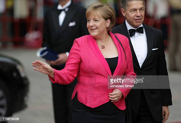 German Chancellor Angela Merkel and her husband Joachim Sauer arrive for the Bayreuth festival 2011 premiere on July 25 2011 in Bayreuth Germany