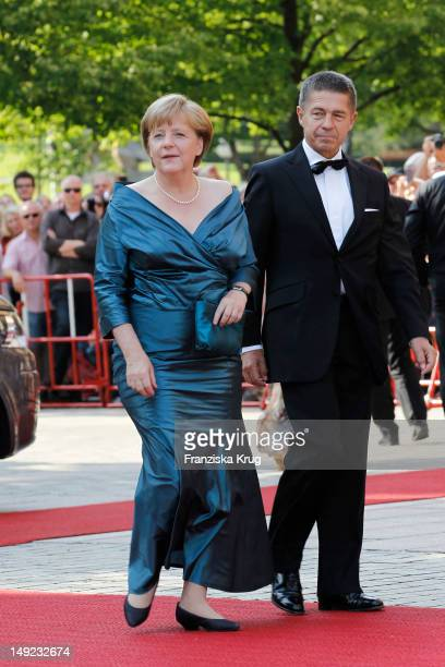 German Chancellor Angela Merkel and her husband Joachim Sauer arrive for the Bayreuth festival 2012 premiere on July 25 2012 in Bayreuth Germany