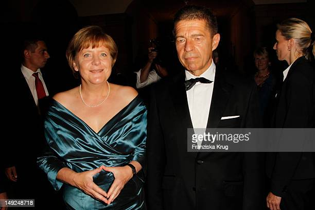 German Chancellor Angela Merkel and her husband Joachim Sauer arrive for the reception of the Bavarian state governor after the Bayreuth festival...