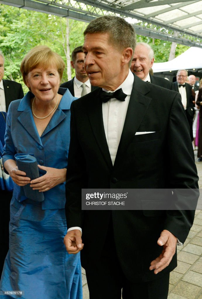 German Chancellor Angela Merkel and her husband Joachim Sauer arrive for the opera 'Siegfried' of the Bayreuth Wagner Opera Festival at the opera...