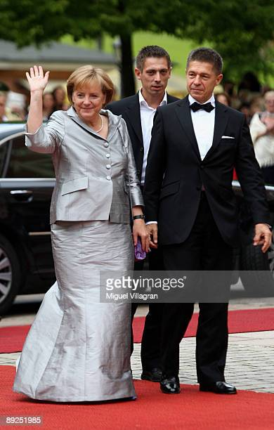 German Chancellor Angela Merkel and her husband Joachim Sauer arrive for the 'Tristan and Isolde' premiere of the Richard Wagner festival on July 25...