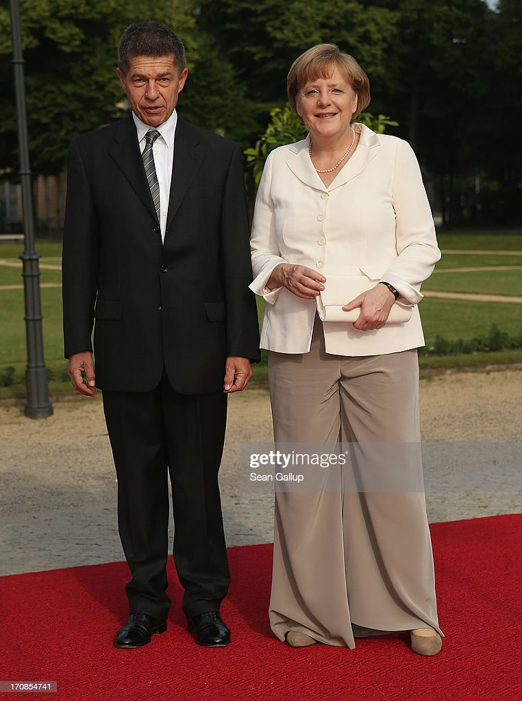 German Chancellor <a gi-track='captionPersonalityLinkClicked' href=/galleries/search?phrase=Angela+Merkel&family=editorial&specificpeople=202161 ng-click='$event.stopPropagation()'>Angela Merkel</a> and her husband <a gi-track='captionPersonalityLinkClicked' href=/galleries/search?phrase=Joachim+Sauer&family=editorial&specificpeople=687595 ng-click='$event.stopPropagation()'>Joachim Sauer</a> attend the dinner given in honour of U.S. President Barack Obama at the Orangerie of Schloss Charlottenburg palace on June 19, 2013 in Berlin, Germany. Obama is visiting Berlin for the first time during his presidency and his speech at the Brandenburg Gate is to be the highlight. Obama will be speaking close to the 50th anniversary of the historic speech by then U.S. President John F. Kennedy in Berlin in 1963, during which he proclaimed the famous sentence: 'Ich bin ein Berliner.'