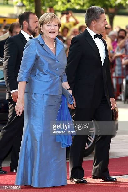 German Chancellor Angela Merkel and her husband Joachim Sauer attend Bayreuth Festival Opening 2013 on July 25 2013 in Bayreuth Germany