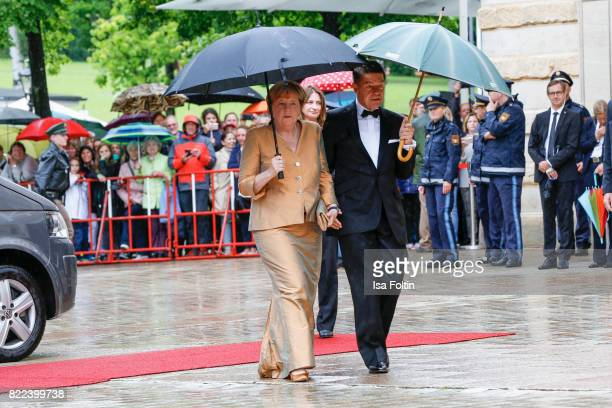 German chancellor Angela Merkel and her husband Joachim Sauer attend the Bayreuth Festival 2017 Opening on July 25 2017 in Bayreuth Germany
