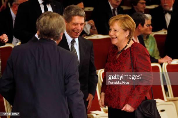 German Chancellor Angela Merkel and her husband Joachim Sauer attend the ReOpening of the Staatsoper Unter den Linden on October 3 2017 in Berlin...
