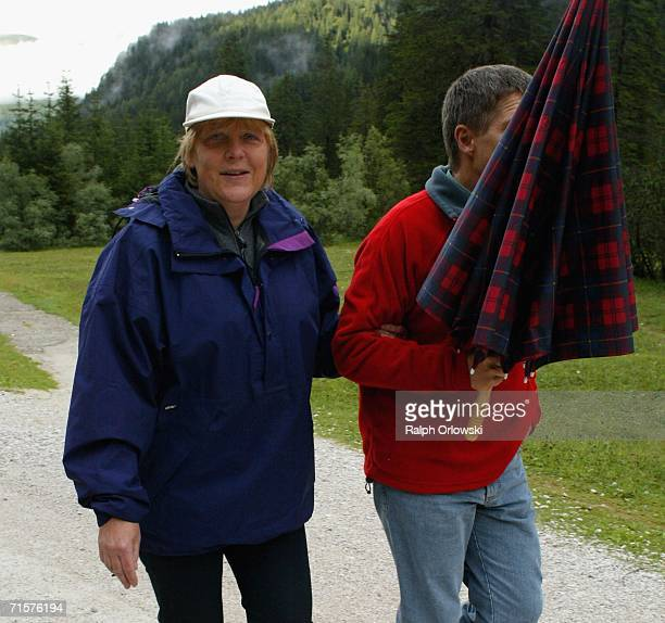 German Chancellor Angela Merkel and her husband Joachim Sauer go for a walk on August 3 2006 in Sexten Italy Merkel and Sauer are currently spending...