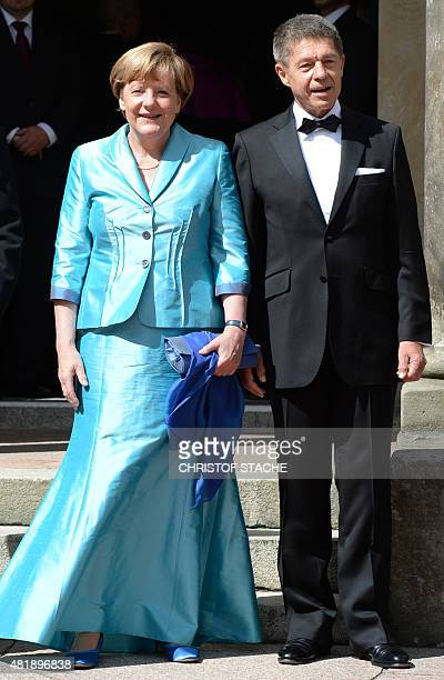 German Chancellor Angela Merkel and her husband Joachim Sauer pose upon arrival for the opening of the Bayreuth Wagner Opera Festival with the...