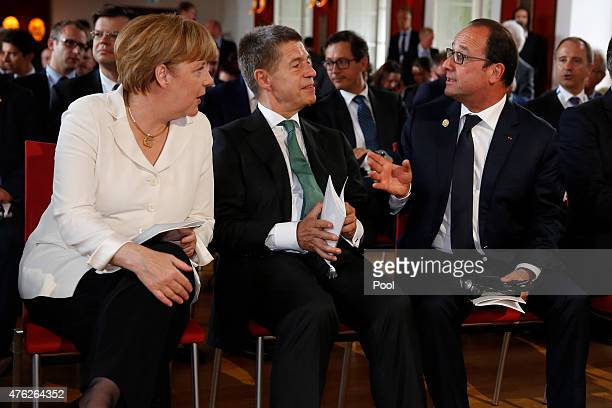 German Chancellor Angela Merkel and her husband Joachim Sauer speak with French President Francois Hollande at an evening concert prior the summit of...