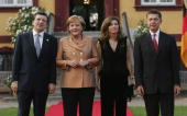 German Chancellor Angela Merkel and her husband Joachim Sauer welcome European Commission President Jose Manuel Barroso and his wife Margarida Sousa...