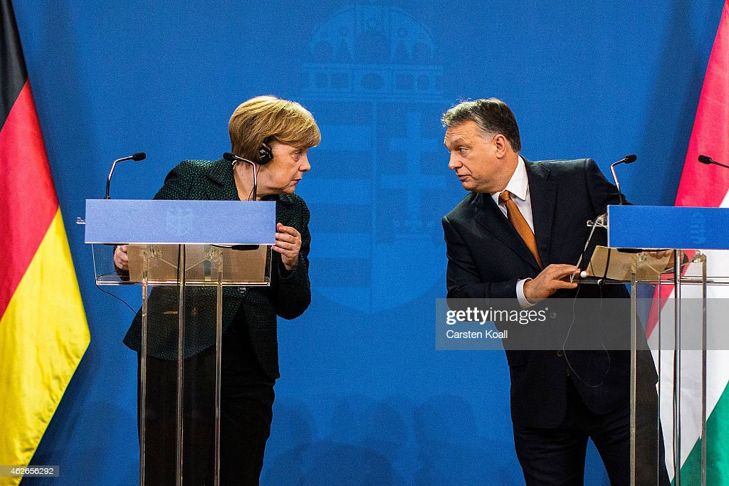 German Chancellor <a gi-track='captionPersonalityLinkClicked' href=/galleries/search?phrase=Angela+Merkel&family=editorial&specificpeople=202161 ng-click='$event.stopPropagation()'>Angela Merkel</a> (L) and Hungarian Prime Minister <a gi-track='captionPersonalityLinkClicked' href=/galleries/search?phrase=Viktor+Orban&family=editorial&specificpeople=4685765 ng-click='$event.stopPropagation()'>Viktor Orban</a> (R) speak to each other following talks on February 2, 2015 in Budapest, Hungary. Merkel is on a one-day visit to the Hungarian capital in a trip that includes meetings with government leaders, discussions with students at Andrassy University and meetings with local Jewish leaders. Merkel's visit was preceded the day before by demonstrations against the Orban government.