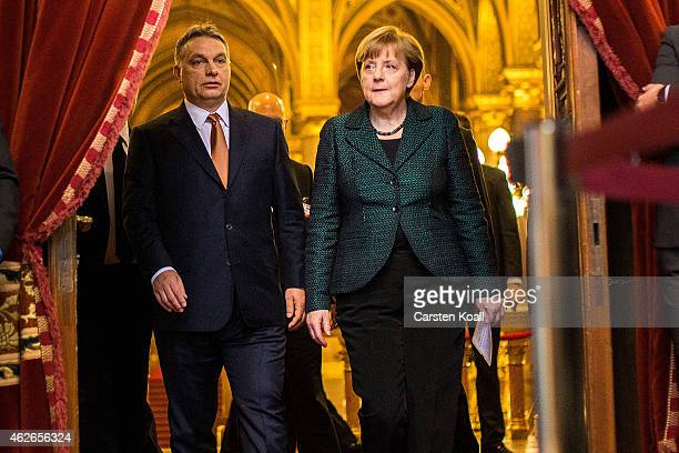 German Chancellor Angela Merkel and Hungarian Prime Minister Viktor Orban arrive for a press conference following talks on February 2 2015 in...