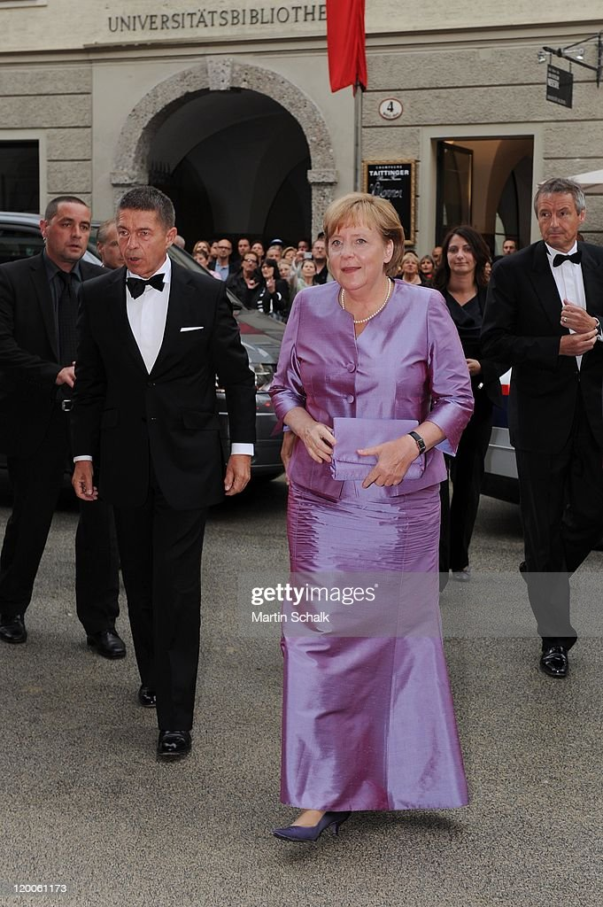 German Chancellor Angela Merkel and husband Joachim Sauer attend the 'Die Frau ohne Schatten' Premiere at the great festival hall during the Salzburg...
