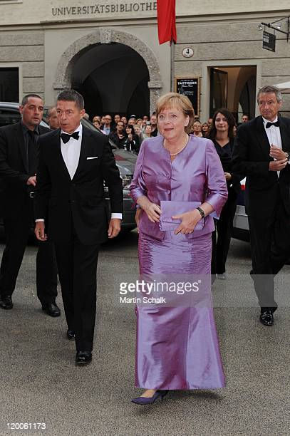 German Chancellor Angela Merkel and husband Joachim Sauer attend the 'Die Frau ohne Schatten' Premiere at the great festival hall during the Salzburg...