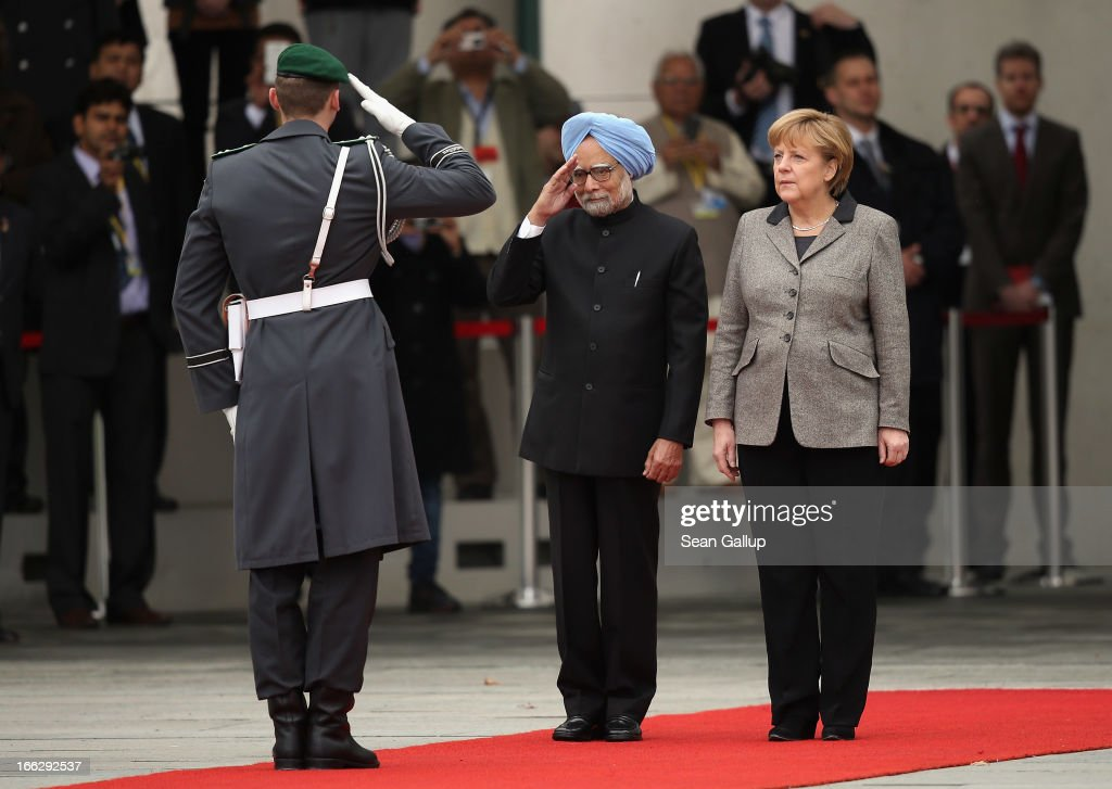 German Chancellor Angela Merkel (R) and Indian Prime Minister <a gi-track='captionPersonalityLinkClicked' href=/galleries/search?phrase=Manmohan+Singh&family=editorial&specificpeople=227120 ng-click='$event.stopPropagation()'>Manmohan Singh</a> finish reviewing a guard of honour upon Singh's arrival at the Chancellery on April 11, 2013 in Berlin, Germany. Singh and the Indian government are in Berlin to participate in German-Indian government consultations.