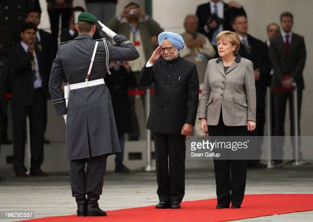 German Chancellor Angela Merkel and Indian Prime Minister Manmohan Singh finish reviewing a guard of honour upon Singh's arrival at the Chancellery...