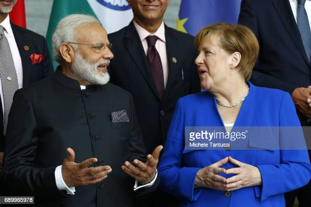 German Chancellor Angela Merkel and Indian Prime Minister Narendra Modi arrive for the group photo of the German and Indian governments prior to...