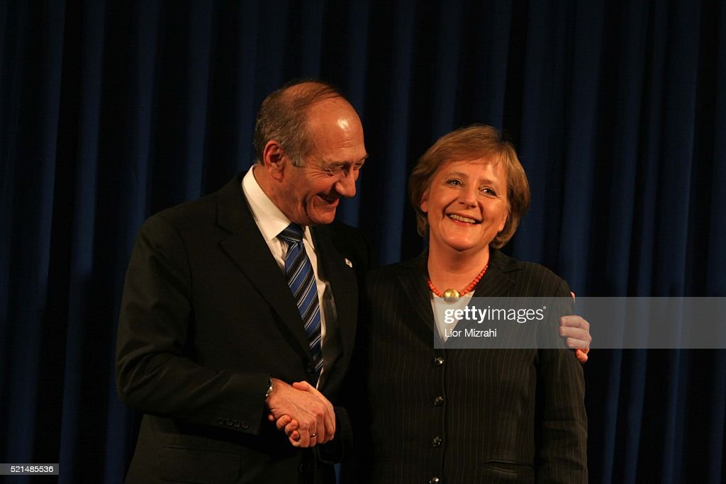 German Chancellor <a gi-track='captionPersonalityLinkClicked' href=/galleries/search?phrase=Angela+Merkel&family=editorial&specificpeople=202161 ng-click='$event.stopPropagation()'>Angela Merkel</a> (R) and interim Israeli Prime Minister <a gi-track='captionPersonalityLinkClicked' href=/galleries/search?phrase=Ehud+Olmert&family=editorial&specificpeople=178946 ng-click='$event.stopPropagation()'>Ehud Olmert</a> smile after a joint news conference in Jerusalem Sunday January 29, 2006. The European Union would not be able to fund the Palestinian Authority under Hamas if it does not renounce violence and recognise Israel, Merkel said on Sunday in Jerusalem.