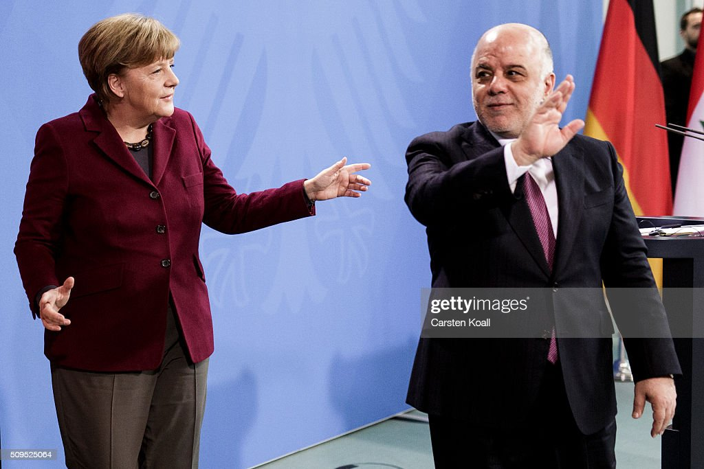 German Chancellor Angela Merkel and Iraqi Prime Minister Haider al-Abadi (R) leave a press conference following talks at the Chancellery on February 11, 2016 in Berlin, Germany. The two leaders discussed, among other issues, the security situation in Iraq as well as the recent influx of large numbers of migrants and refugees from Iraq into Germany.