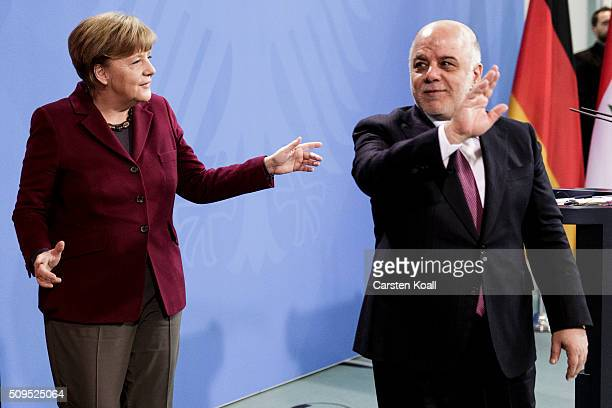 German Chancellor Angela Merkel and Iraqi Prime Minister Haider alAbadi leave a press conference following talks at the Chancellery on February 11...