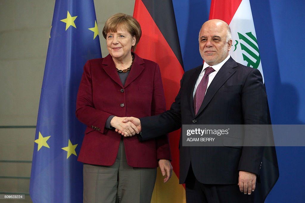 German Chancellor Angela Merkel (L) and Iraqi Prime Minister Haider al-Abadi shake hands at a joint press conference after meeting at the Chancellery in Berlin on February 11, 2016. / AFP / Adam BERRY