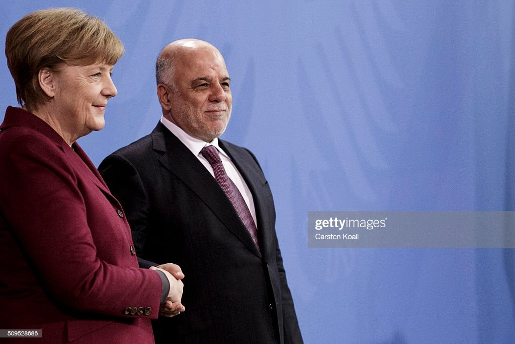 German Chancellor <a gi-track='captionPersonalityLinkClicked' href=/galleries/search?phrase=Angela+Merkel&family=editorial&specificpeople=202161 ng-click='$event.stopPropagation()'>Angela Merkel</a> and Iraqi Prime Minister Haider al-Abadi (R) posing for the media following talks at the Chancellery on February 11, 2016 in Berlin, Germany. The two leaders discussed, among other issues, the security situation in Iraq as well as the recent influx of large numbers of migrants and refugees from Iraq into Germany.