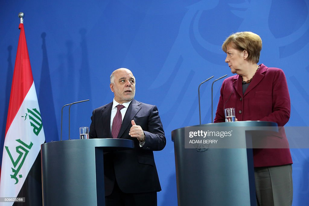 German Chancellor Angela Merkel (R) and Iraqi Prime Minister Haider al-Abadi give a joint press conference after meeting at the Chancellery in Berlin on February 11, 2016. / AFP / Adam BERRY