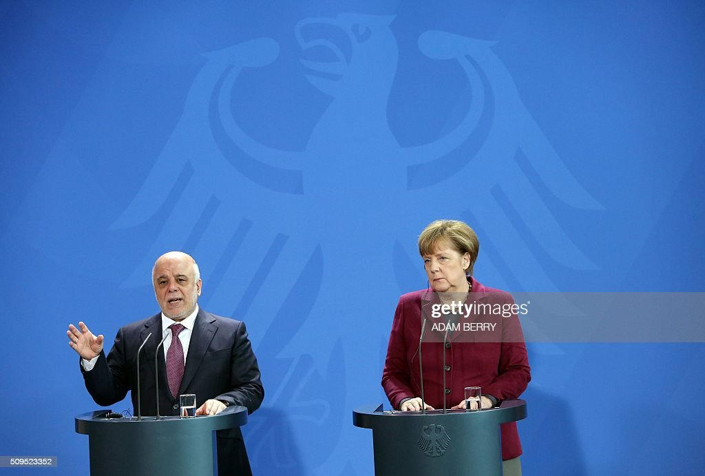 German Chancellor Angela Merkel (L) and Iraqi Prime Minister Haider al-Abadi give a joint press conference at the Chancellery in Berlin on February 11, 2016. / AFP / Adam BERRY