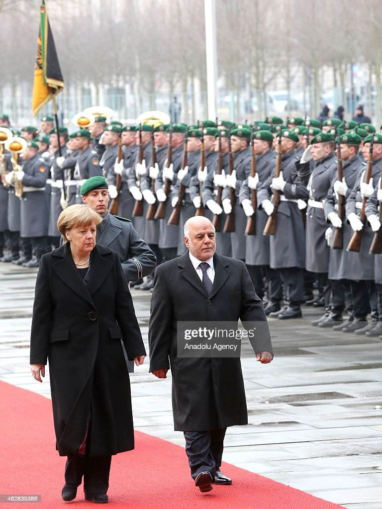 German Chancellor Angela Merkel and Iraqi Prime Minister Haider alAbadi review the honor guard during the official welcome at the Chancellery before...
