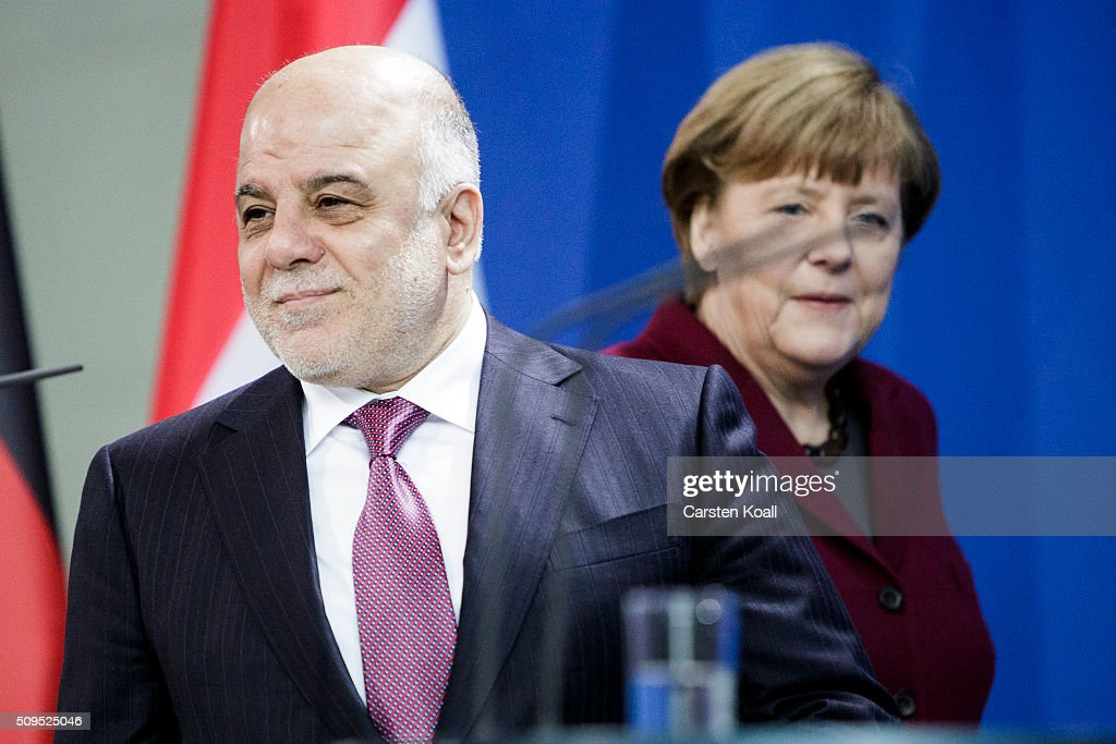 German Chancellor <a gi-track='captionPersonalityLinkClicked' href=/galleries/search?phrase=Angela+Merkel&family=editorial&specificpeople=202161 ng-click='$event.stopPropagation()'>Angela Merkel</a> and Iraqi Prime Minister Haider al-Abadi (L) arrive to speak to the media following talks at the Chancellery on February 11, 2016 in Berlin, Germany. The two leaders discussed, among other issues, the security situation in Iraq as well as the recent influx of large numbers of migrants and refugees from Iraq into Germany.