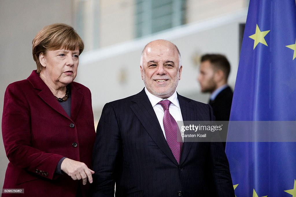 German Chancellor <a gi-track='captionPersonalityLinkClicked' href=/galleries/search?phrase=Angela+Merkel&family=editorial&specificpeople=202161 ng-click='$event.stopPropagation()'>Angela Merkel</a> and Iraqi Prime Minister Haider al-Abadi (R) arrive to speak to the media following talks at the Chancellery on February 11, 2016 in Berlin, Germany. The two leaders discussed, among other issues, the security situation in Iraq as well as the recent influx of large numbers of migrants and refugees from Iraq into Germany.