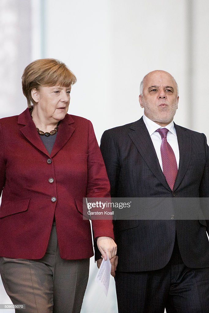 German Chancellor Angela Merkel and Iraqi Prime Minister Haider al-Abadi (R) arrive to speak to the media following talks at the Chancellery on February 11, 2016 in Berlin, Germany. The two leaders discussed, among other issues, the security situation in Iraq as well as the recent influx of large numbers of migrants and refugees from Iraq into Germany.
