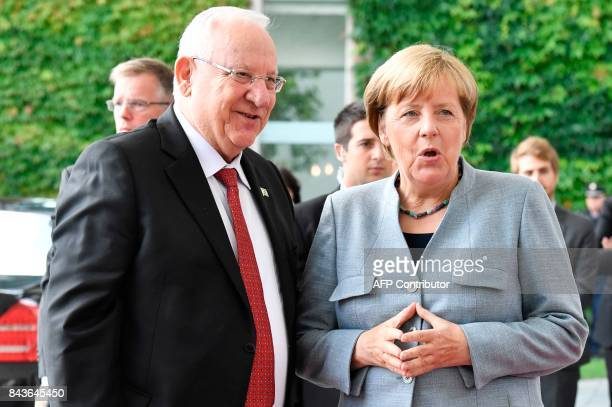 German Chancellor Angela Merkel and Israeli President Reuven Rivlin pose for photographers at the chancellery in Berlin on September 7 2017 / AFP...