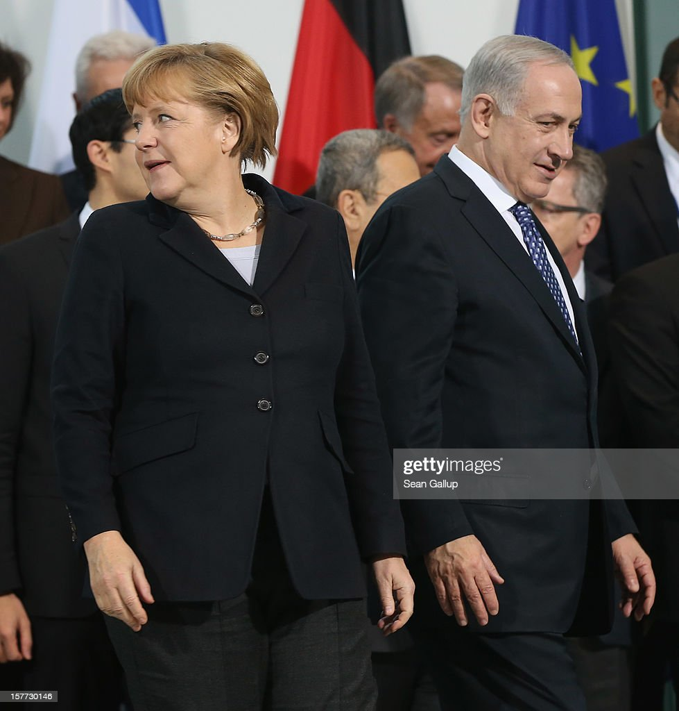 German Chancellor <a gi-track='captionPersonalityLinkClicked' href=/galleries/search?phrase=Angela+Merkel&family=editorial&specificpeople=202161 ng-click='$event.stopPropagation()'>Angela Merkel</a> and Israeli Prime Minister Benjamin Netanyahu depart after posing for a group delegaitons photo at the Chancellery on December 6, 2012 in Berlin, Germany. The German and Israeli governments are meeting today in Berlin for German-Israeli government consultations.