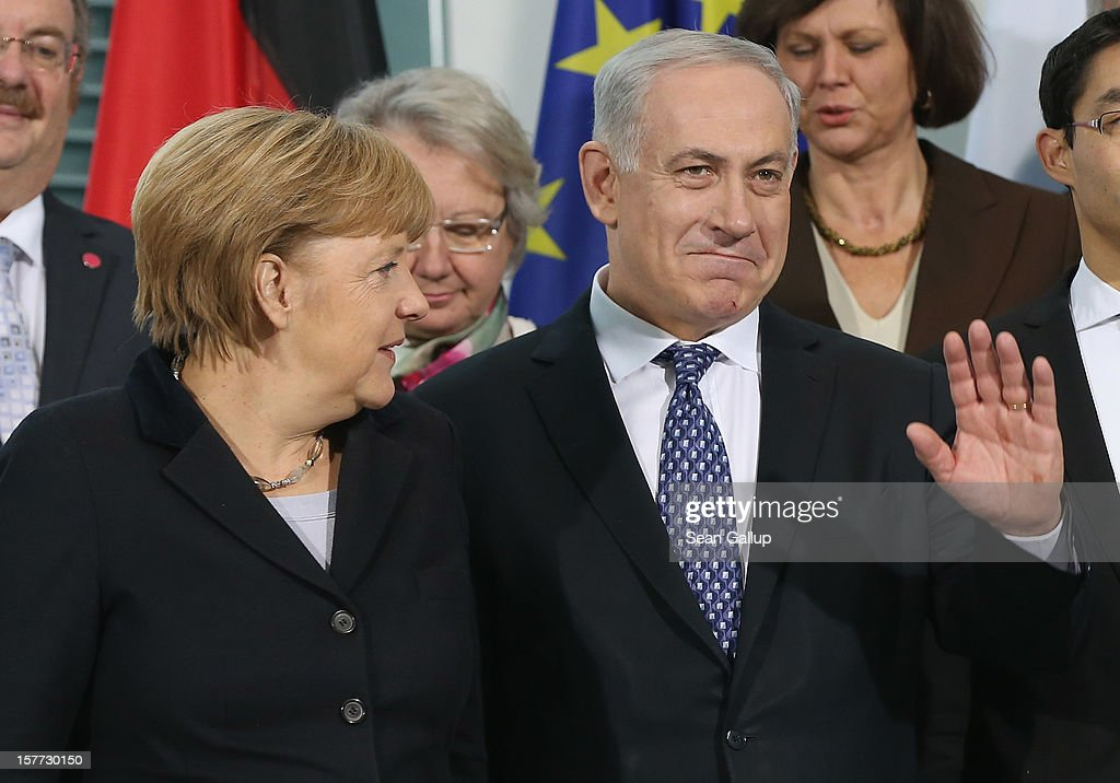 German Chancellor Angela Merkel and Israeli Prime Minister Benjamin Netanyahu depart after posing for a group delegaitons photo at the Chancellery on December 6, 2012 in Berlin, Germany. The German and Israeli governments are meeting today in Berlin for German-Israeli government consultations.