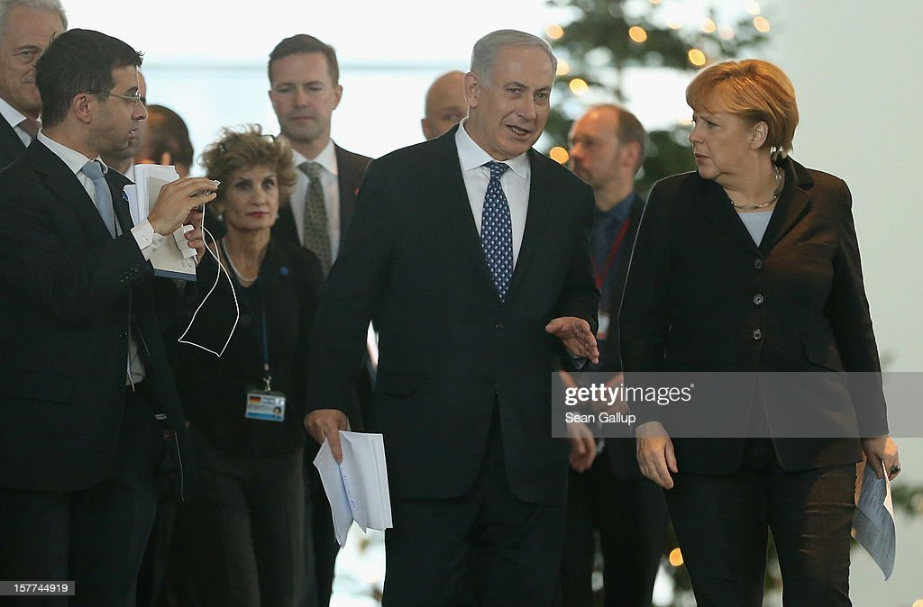 German Chancellor <a gi-track='captionPersonalityLinkClicked' href=/galleries/search?phrase=Angela+Merkel&family=editorial&specificpeople=202161 ng-click='$event.stopPropagation()'>Angela Merkel</a> and Israeli Prime Minister Benjamin Netanyahu arrive to speak to the media following talks at the Chancellery on December 6, 2012 in Berlin, Germany. The German and Israeli governments are meeting today in Berlin for German-Israeli government consultations.