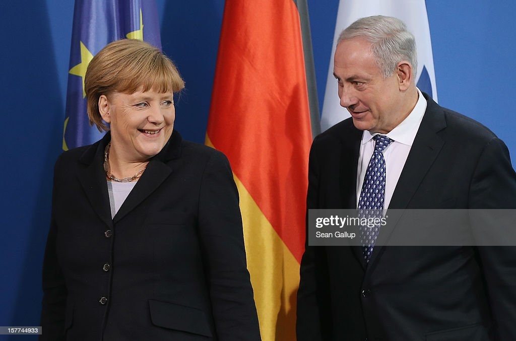 German Chancellor Angela Merkel and Israeli Prime Minister Benjamin Netanyahu depart after speaking to the media following talks at the Chancellery on December 6, 2012 in Berlin, Germany. The German and Israeli governments are meeting today in Berlin for German-Israeli government consultations.
