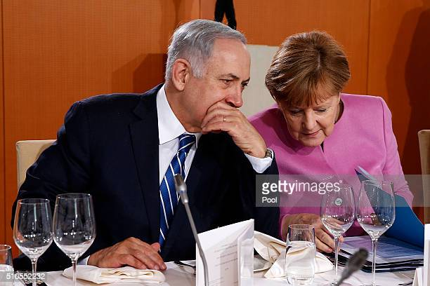 German Chancellor Angela Merkel and Israeli Prime Minister Benjamin Netanyahu attend a lunch during the 6th GermanIsraeli government consultations at...