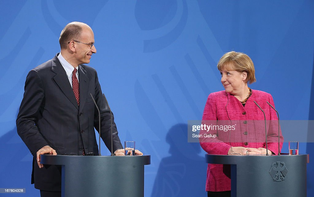 German Chancellor <a gi-track='captionPersonalityLinkClicked' href=/galleries/search?phrase=Angela+Merkel&family=editorial&specificpeople=202161 ng-click='$event.stopPropagation()'>Angela Merkel</a> and Italian Prime Minister <a gi-track='captionPersonalityLinkClicked' href=/galleries/search?phrase=Enrico+Letta&family=editorial&specificpeople=2915592 ng-click='$event.stopPropagation()'>Enrico Letta</a> speak to the media following talks at the Chancellery on April 30, 2013 in Berlin, Germany. Letta is in Germany on his first official foreign visit abroad since taking office. The two leaders discussed the current financial situation in Europe.
