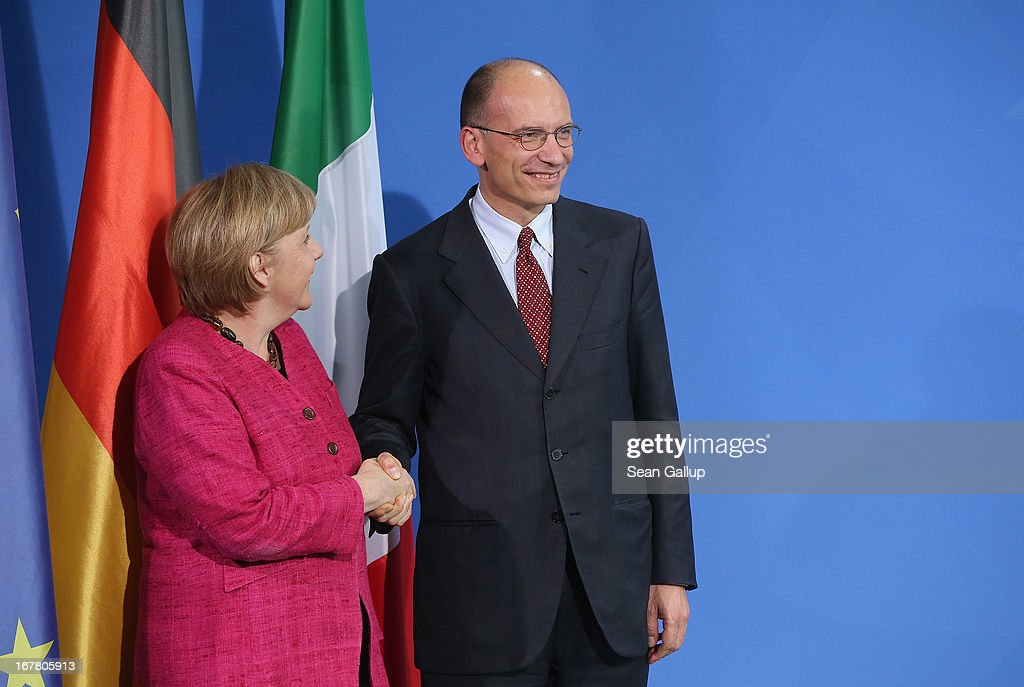 German Chancellor <a gi-track='captionPersonalityLinkClicked' href=/galleries/search?phrase=Angela+Merkel&family=editorial&specificpeople=202161 ng-click='$event.stopPropagation()'>Angela Merkel</a> and Italian Prime Minister <a gi-track='captionPersonalityLinkClicked' href=/galleries/search?phrase=Enrico+Letta&family=editorial&specificpeople=2915592 ng-click='$event.stopPropagation()'>Enrico Letta</a> depart after speaking to the media following talks at the Chancellery on April 30, 2013 in Berlin, Germany. Letta is in Germany on his first official foreign visit abroad since taking office. The two leaders discussed the current financial situation in Europe.