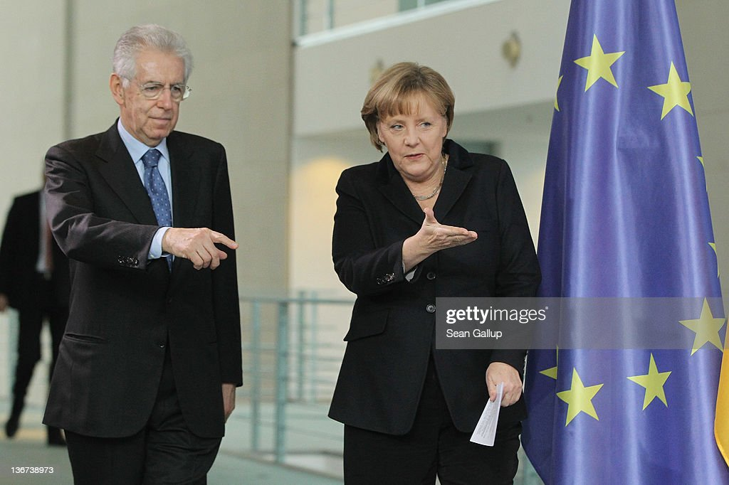 German Chancellor Angela Merkel and Italian Prime Minister Mario Monti arrive to speak to the media after talks at the Chancellery on January 11, 2011 in Berlin, Germany. Monti is in Berlin to seek more support for Italy in recognition of austerity measures his government is pushing through in order to bring the Italy's debt situation under control.