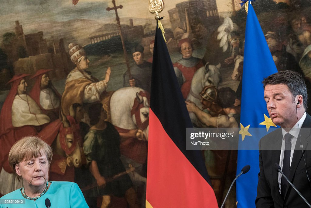 German Chancellor <a gi-track='captionPersonalityLinkClicked' href=/galleries/search?phrase=Angela+Merkel&family=editorial&specificpeople=202161 ng-click='$event.stopPropagation()'>Angela Merkel</a> and Italian Prime Minister Matteo Renzi give a press conference during a meeting in Rome's Palazzo Chigi government office on May 05, 2016. EU president Donald Tusk travels to Rome with fellow EU institution leaders and German Chancellor <a gi-track='captionPersonalityLinkClicked' href=/galleries/search?phrase=Angela+Merkel&family=editorial&specificpeople=202161 ng-click='$event.stopPropagation()'>Angela Merkel</a> for two days of talks likely to focus on next steps in Europe's migrant crisis.