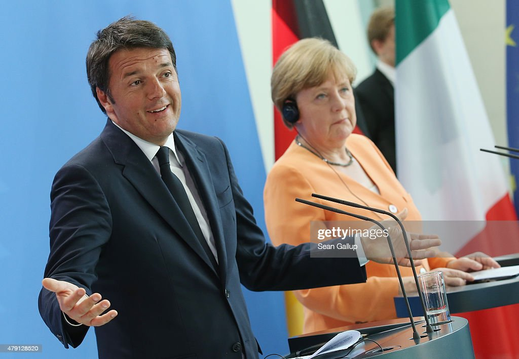 German Chancellor <a gi-track='captionPersonalityLinkClicked' href=/galleries/search?phrase=Angela+Merkel&family=editorial&specificpeople=202161 ng-click='$event.stopPropagation()'>Angela Merkel</a> and Italian Prime Minister <a gi-track='captionPersonalityLinkClicked' href=/galleries/search?phrase=Matteo+Renzi&family=editorial&specificpeople=6689301 ng-click='$event.stopPropagation()'>Matteo Renzi</a> speak to the media following talks at the Chancellery on July 1, 2015 in Berlin, Germany. The two leaders discussed the Greek debt crisis and Europe's refugee situation, among other issues.