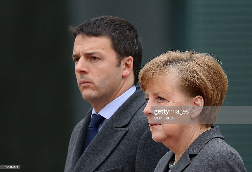 German Chancellor <a gi-track='captionPersonalityLinkClicked' href=/galleries/search?phrase=Angela+Merkel&family=editorial&specificpeople=202161 ng-click='$event.stopPropagation()'>Angela Merkel</a> and Italian Prime Minister <a gi-track='captionPersonalityLinkClicked' href=/galleries/search?phrase=Matteo+Renzi&family=editorial&specificpeople=6689301 ng-click='$event.stopPropagation()'>Matteo Renzi</a> listen to their countries' respective national anthems upon Rnezi's arrival at the Chancellery for German and Italian government consultations on March 17, 2014 in Berlin, Germany. This is the first meeting of its kind between the two government since Renzi took office in February.