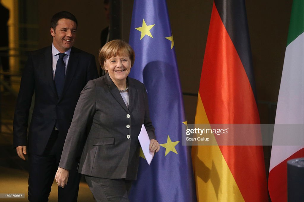 German Chancellor <a gi-track='captionPersonalityLinkClicked' href=/galleries/search?phrase=Angela+Merkel&family=editorial&specificpeople=202161 ng-click='$event.stopPropagation()'>Angela Merkel</a> and Italian Prime Minister Matteo Rentzi arrive to speak to the media following German and Italian government consultations at the Chancellery on March 17, 2014 in Berlin, Germany. This is the first meeting of its kind between the two governments since Renzi took office in February.