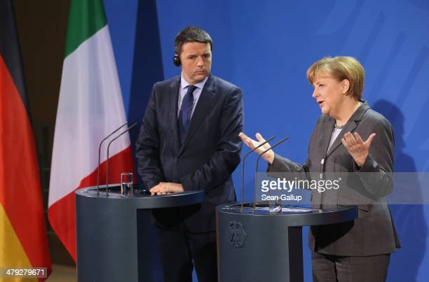 German Chancellor Angela Merkel and Italian Prime Minister Matteo Rentzi speak to the media following German and Italian government consultations at...