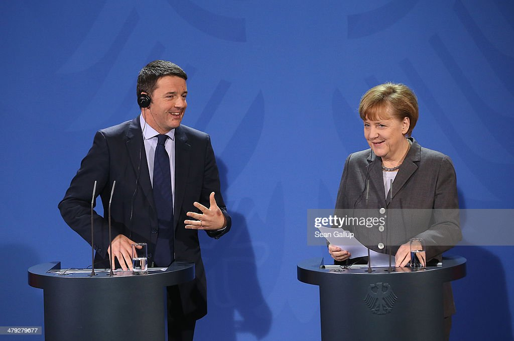 German Chancellor <a gi-track='captionPersonalityLinkClicked' href=/galleries/search?phrase=Angela+Merkel&family=editorial&specificpeople=202161 ng-click='$event.stopPropagation()'>Angela Merkel</a> and Italian Prime Minister Matteo Rentzi speak to the media following German and Italian government consultations at the Chancellery on March 17, 2014 in Berlin, Germany. This is the first meeting of its kind between the two governments since Renzi took office in February.