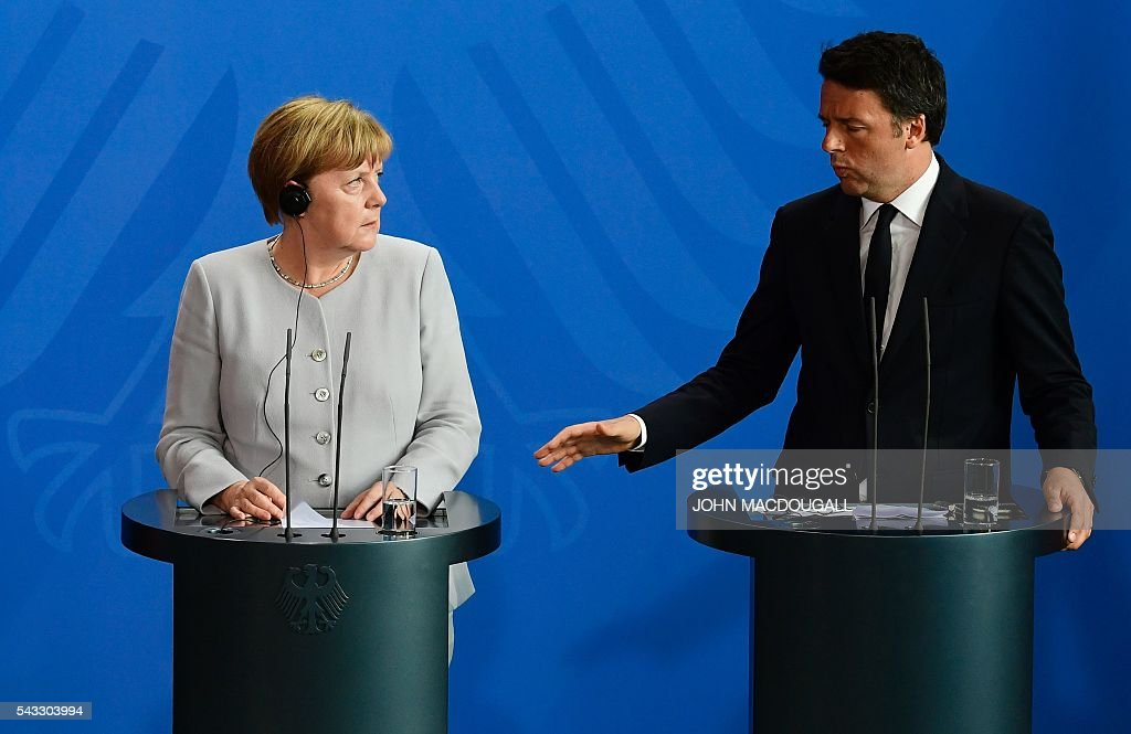 German Chancellor Angela Merkel (L) and Italy's Prime Minister Matteo Renzi address a joint press conference with the French President ahead of talks following the Brexit referendum at the chancellery in Berlin, on June 27, 2016. Britain's shock decision to leave the EU forces German Chancellor Angela Merkel into the spotlight to save the bloc, but true to her reputation for prudence, she said she would act neither hastily nor nastily. / AFP / John MACDOUGALL