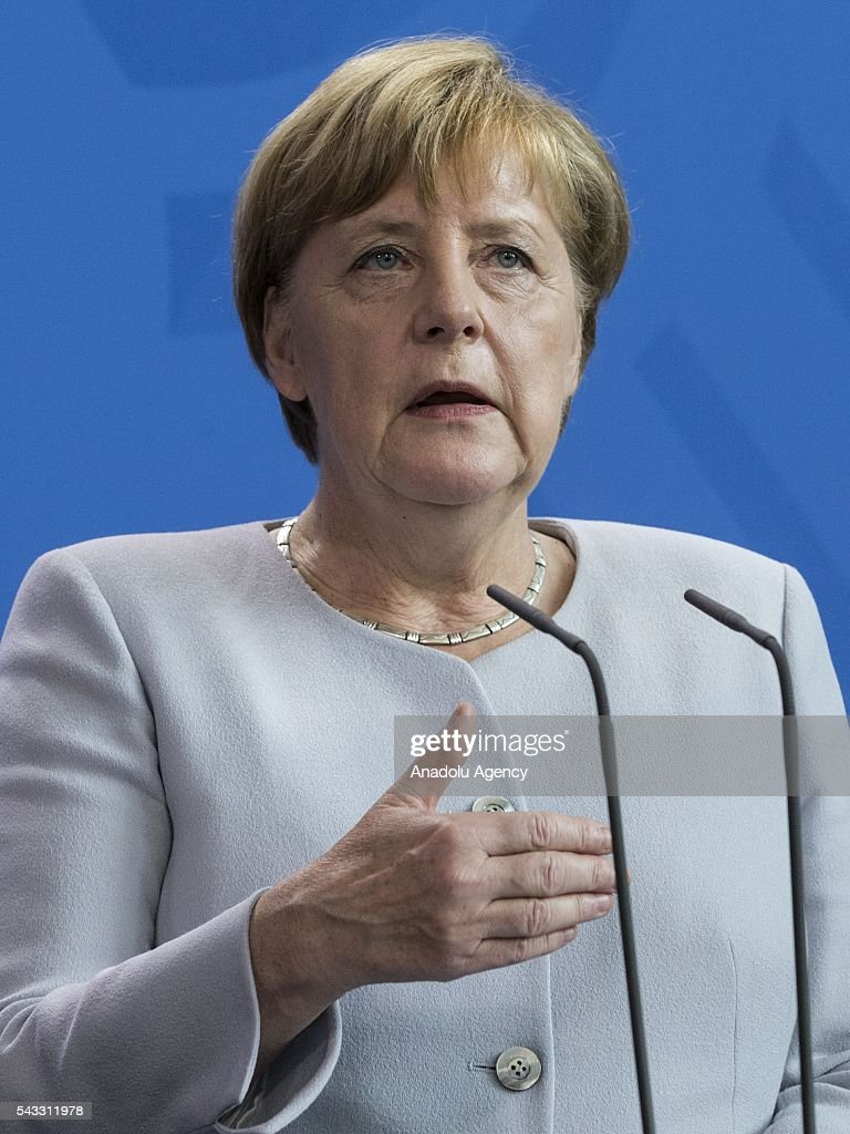 German Chancellor Angela Merkel, (not seen) and Italy's Prime Minister Matteo Renzi (not seen) address a press conference ahead of talks following the Brexit referendum at the chancellery in Berlin, on June 27, 2016.